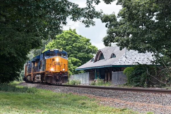 CSX train Q008 rumbles past the historic Warren MA station.<br /> 6/24/2020