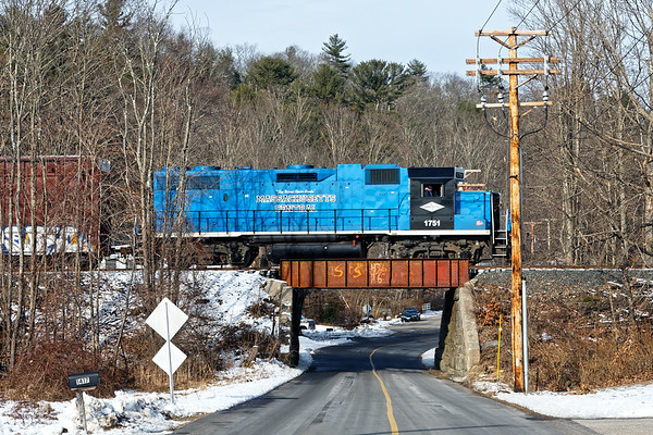 After switching in Ware, MCER 1751 heads north through Gilbertville with one boxcar for Barre.<br /> 12/11/2020