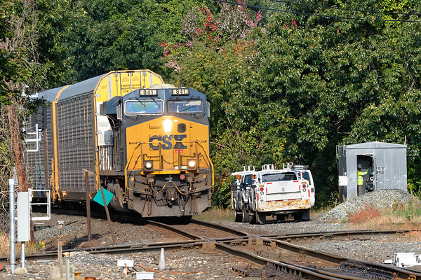 With one unit on the point and a mid train DPU, Q264 crosses the diamond at MP83 with a long drag of auto racks for the EBSR.<br /> 9/25/2020