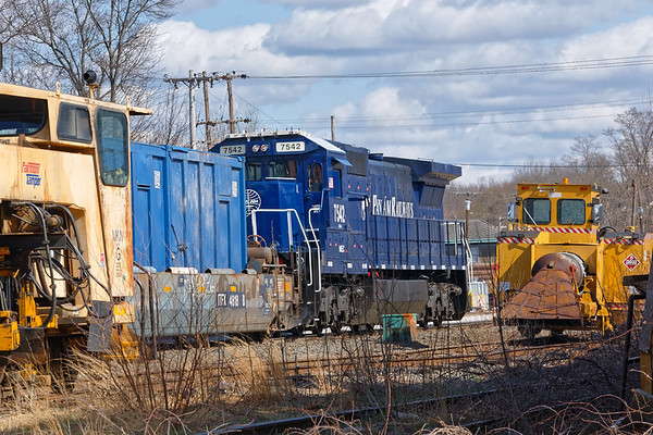 Between a tamper and a snow jet, I get a glimpse of PanAm 7542 (AY-1) working the Hill Yard in Ayer MA.<br /> 4/15/2020