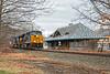 CSX train Q022 rolls by the historic station in Warren MA.<br /> 1/17/2021