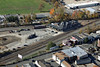 The historic Palmer Depot  (now housing the Steaming Tender Restaurant) sits near the diamond at MP83 where the NECR (upper tracks) crosses the CSX Boston Line (lower tracks). And sitting in the parking lot is a 1915 Porter. 10/17/2012 - 598C3150dK