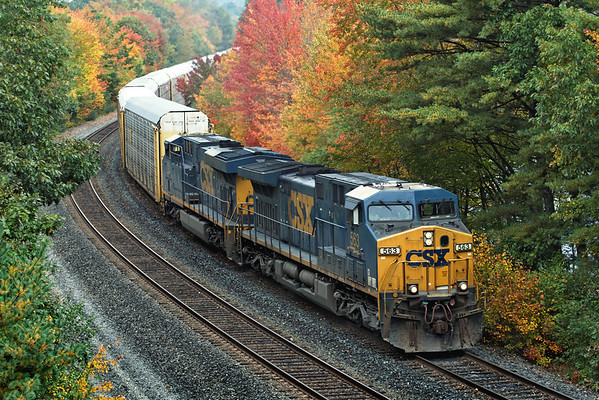 CSX train pulls down the siding in Spencer, MA with auto racks for the East Brookfield & Spencer. 10/02/2012 - 598C2604dK