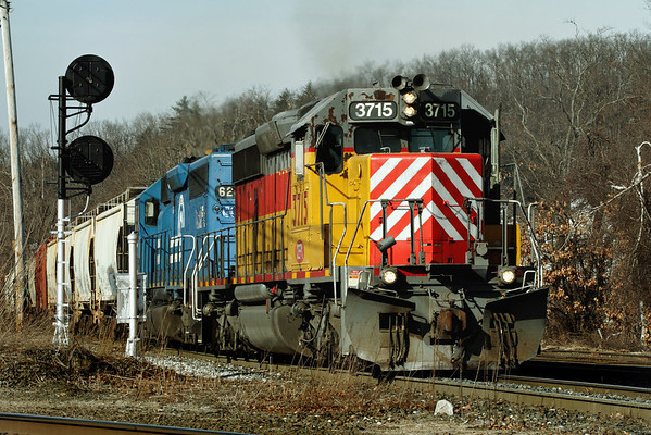 Always colorful New England Central pulls a long freight south across the diamond at MP83, Palmer, MA. 1/31/12 - IMG_3472dK