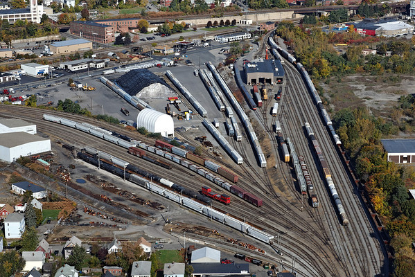Aerial view of the Providence and Worcester yard in Worcester, MA. The CSX Boston Line runs across the top of the image and the P&W headquarters is the large brick building in the upper left. 10/17/2012 - 598C2975dK