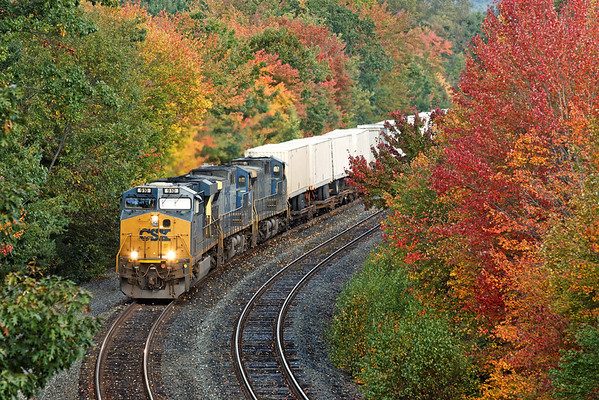 Early this morning, CSX train Q012 runs through some Fall color east of MP64 on the CSX Boston Line. 10/1/2012 - 598C2568dK2