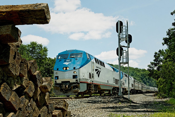 Amtrak 449 rolls West past the signal tower and a pile of ties left over from recent track work at MP60, Spencer, MA. 7/6/2012 - 598C0066dK