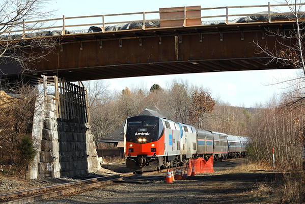 Amtrak train 449, with 156 on the point, heads west by the old depot and under the new bridge at about MP70, West Brookfield, MA on the CSX Boston Line. 11/12/12 - 598C3771dK