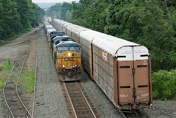 On a hazy, hot summer afternoon, CSX train Q022 takes the main at MP64, East Brookfield, MA past some cripples left by Q293 earlier in the day. 7/15/2012 - 598C9286dK