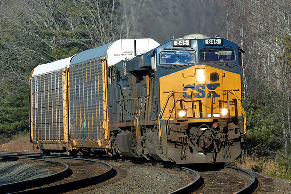 After dropping a cut of auto racks for the East Brookfield and Spencer at MP60, train Q264 heads east to Worcester with a couple of cars for the P&W. 12/14/2012 - 598C5051dK
