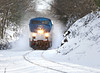 Amtrak 449 heads west through the new snow in the rock cut near the top of the Charlton Hill just east of MP57, Charlton, MA. 12/30/2012 - 598C5332dK