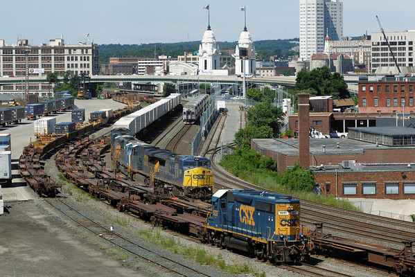 Eastbound CSX train Q012 coming into the Worcester, MA yard passing the MBTA commuter train which is just pulling into Union Station. 7/3/1012 - 598C9993dK