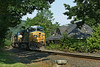 A short Eastbound train of UPS trailers led by three units passes the old railroad depot in the center of Warren, MA on the CSX Boston Line. 7/1/2012 - 598C9889dK