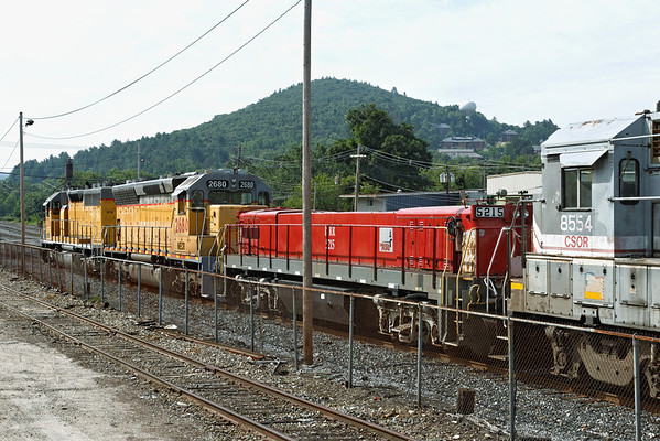 ...and now for something completely different...<br /> Another rainbow consist in the NECR yards at MP83, Palmer, MA, only this time with ISRR yard slug 5215 between CSOR 8554 and NECR 2680. 7/15/2012 - 598C9230dK