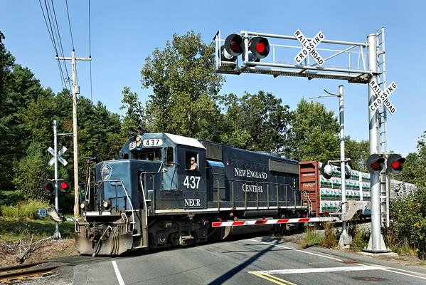 "NECR 437 heads south through the ""hospital"" crossing from their yard in Palmer, MA. 9/12/2012 - 598C1003dK"