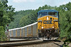 Long Eastbound drag of auto racks crosses over from the main to the siding at MP60, Spencer, MA. 7/3/2012 - 598C0036dK