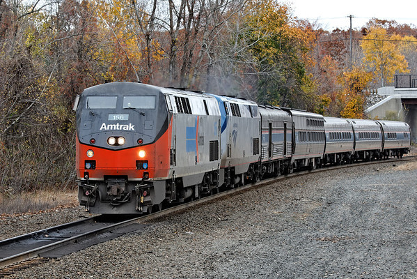 With Amtrak 156 on the point and the last remaining colors of Fall 2012 as a backdrop, train 449 rolls through MP57 in Charlton, MA on the CSX Boston LIne. 10/25/2012 - 598C3343dK