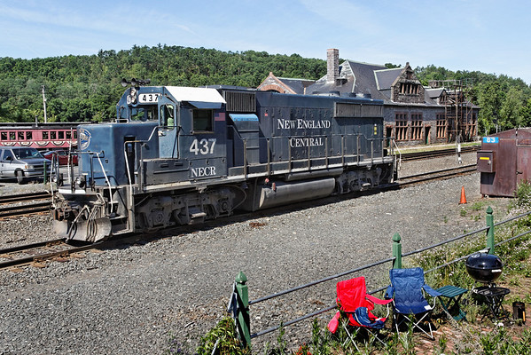 NECR 437 heads back to their yard on the other side of the depot at MP83, Palmer MA. The two chairs in the foreground might be the best seats in the house! 6/24/2012 - 598C9844dK