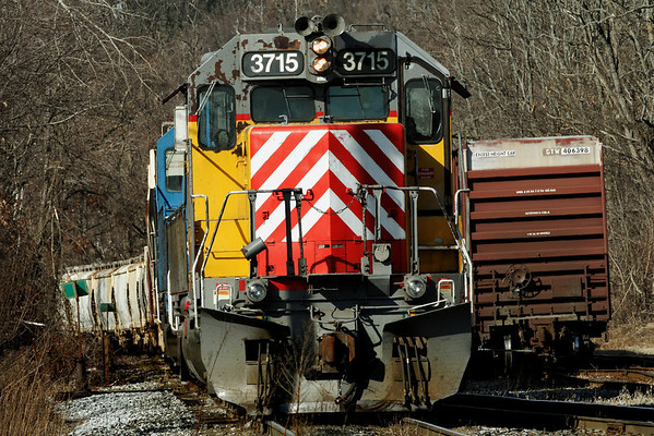 Another colorful NECR consist waits to head south across the diamond at MP83, Palmer, MA. 1/31/12 - MG_3441dK
