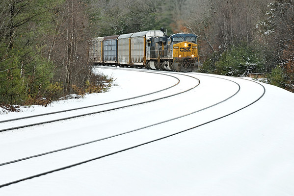 In a break in the snow, CSX train Q264 crosses over to the siding from the main at MP60, Spencer, MA on the CSX Boston Line. 11/08/2012 - 598C3578dK