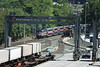 MBTA commuter train heads back into Boston past the new rolling cranes at MP42, at the East end of the CSX yards in Worcester, MA. 7/3/2012 - 598C0012dK