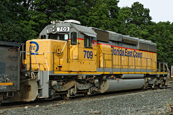 Another visitor from the deep South - FEC 709 sits idle in the CSX yard at MP83, Palmer, MA. 8/19/2012 - 598C0107dK