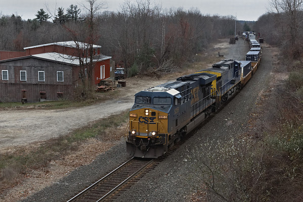 Unlike yesterday, today was a very dark lowry day as train Q022 heads east through MP57 at Charlton, MA on the CSX Boston Line. 11/7/2012 - 598C3561dK