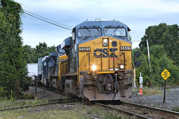 CSX train Q022 hits the diamond at MP83 in Palmer, MA. 9/2/2012 - 598C0708dK