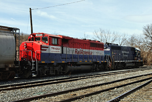 New England Central #417 and RailAmerica #4053 (TWP 4053) make up an unusual consist in the NECR yard in Palmer. MA. 3/12/12 - IMG_3705dK