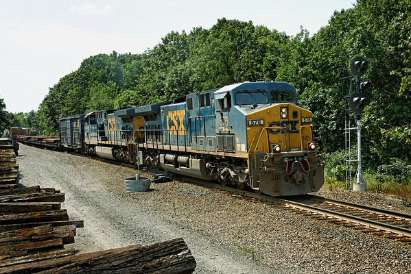 After the previous two trains passed, CSX train Q426 continues East through the signals at MP57, Charlton, MA. The high/wide load was half a dozen flat cars with large steel plates. 7/23/2012 - 598C9455dxK