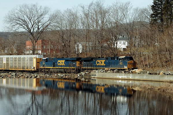 CSX Q264 - same train, same day looking across the mill pond at the old Wright's factory complex in West Warren, MA. 1/31/12 - IMG_3422dK