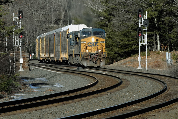 After cutting off a long drag of auto racks in East Brookfield, a half a dozen racks continue east through the curves at MP60, Spencer, MA on the CSX Boston Line. 1/29/12 - IMG_3380dK