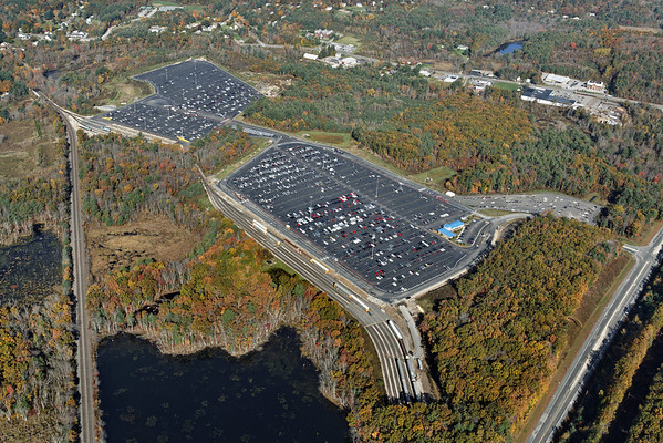 Aerial view, looking west, of the East Brookfield and Spencer auto yard in Spencer, MA. Rte 49 is lower right and the CSX Boston Line is to the left. 10/17/2012 - 598C3020dK
