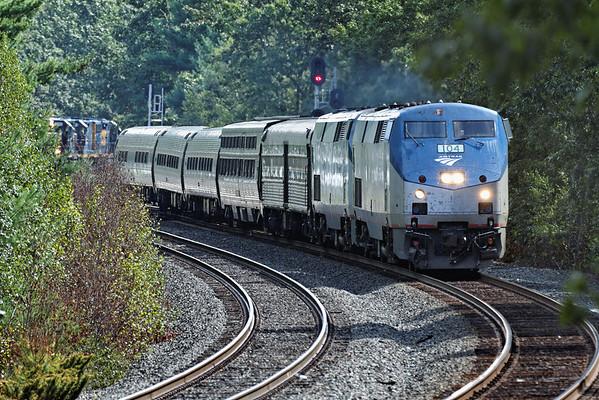 Amtrak 449 rolls past the rail train at MP60, Spencer, MA. 9/5/2012 - 598C0734dK