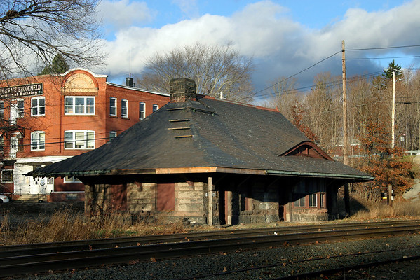 A brief visual tribute to a bit of New England railroad history lost forever, the East Brookfield, MA depot at MP64 on the CSX Boston Line, seen here on November 23, 2005.