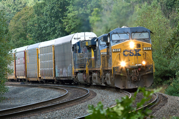 A short string of auto racks heads East through MP60 in Spencer, MA on the CSX Boston Line. Just the slightest hint of Fall color so far. 10-05-2011, 1634LR3dK