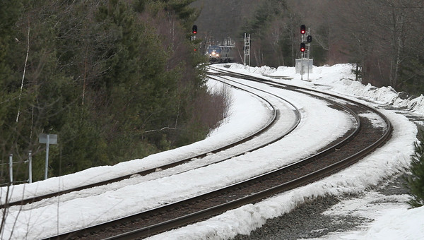 "Amtrak ""Lake Shore Limited"" drifts through MP60, Spencer, MA. The small patches of bare ground are a sign that the seemingly endless Winter may be ending and Spring really is on its way. <br /> February 24, 2011 - MVI_1709"