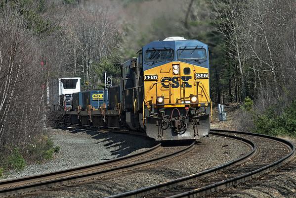 CSX train Q168 through MP60 in Easter morning light - Spencer, MA, April 24, 2011 - IMG_3622dK