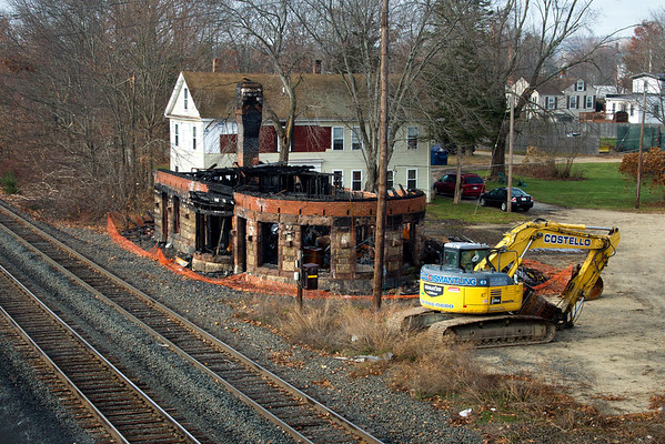 A brief visual tribute to a bit of New England railroad history lost forever, the East Brookfield, MA depot at MP64 on the CSX Boston Line, seen here on December 4, 2011 in the shadow of demolition equipment.