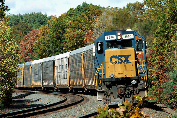 A line of auto racks backs through the Fall foliage at MP60 on the CSX Boston Line. Oct. 21, 2011 - IMG_2061dK