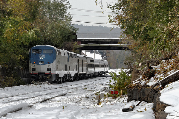 Amtrak 448 sits shut down on the CSX Boston line at MP83, Palmer, MA. Most trains were halted due to dangerous track conditions - trees across the tracks - after the snowstorm on 10/29 and 10/30 dumped more than a foot of heavy, wet snow on the region. Passengers were bussed from Palmer to Boston. Oct 31, 2011 - IMG_2324dK,