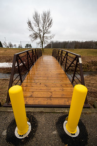 Today I took the Ultra Wide Angle lens out with me. I've never really figured out how to use this lens, so I thought, let's see what we can do.These yellow posts have been recently placed in front of the bridge to stop motorized or horse-drawn traffic.