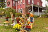 An autumn display with scarecrows and pumpkins at the Old Red Inn and Cottages in North Conway, New Hampshire, USA.