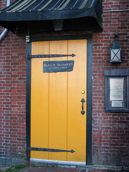 Black Trumpet yellow door