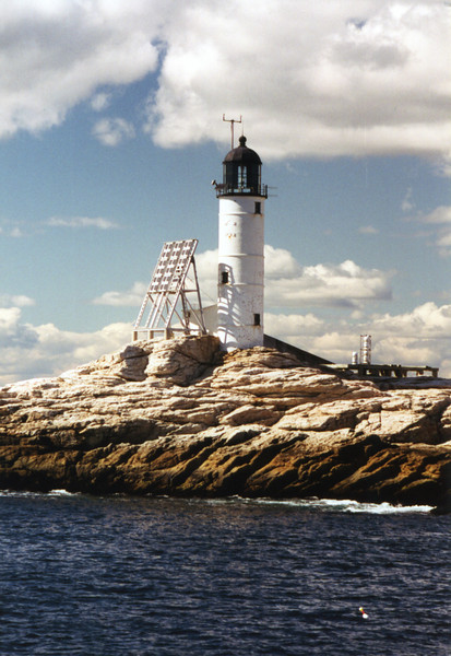 In the 1950's the dwelling was removed and replaced with a modern 1.5 story triplex.  On October 10, 1986 the Coast Guard automated the Isles of Shoals Lighthouse and removed all personnel.  Shorty thereafter the Fresnel lens was removed and replaced by modern aerobeacons.  In 1993 White Island was transferred to the New Hampshire Parks and Recreation Department.  During the following years very little upkeep was done on the lighthouse station and it fell into disrepair.