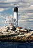 A forty foot tower and a Keepers residence both built of rubblestone were erected and the lighthouse went into service January 1821.  The tower had an iron lantern with 15 lamps arranged on a triangular chandelier.  Originally the lights flashed in a pattern of red, white and blue but the blue light was discontinued as mariners had difficulty seeing it.  The lantern and lighting system were replaced in 1841.