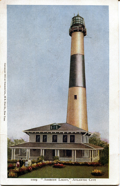An old postcard view of the Absecon Lighthouse in Atlantic City, New Jersey and the Head Keepers home.