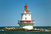 In 1827 an attempt was made to erect a wooden pile lighthouse on Brandywine Shoal.  The structure was seriously damaged before it was completed which required repairs; however the aid only lasted for 12 months before succumbing to the sea.  The lightship continued on station at the shoal until the second attempt to erect a lighthouse.