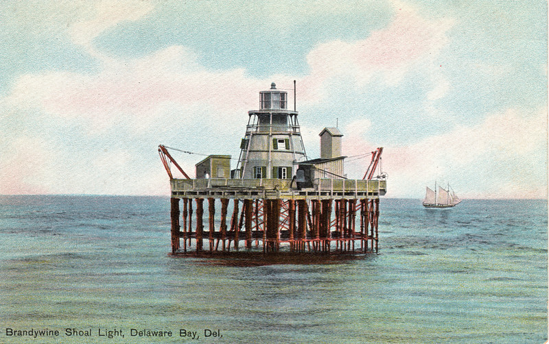 A postcard view of the original pile lighthouse built on Brandywine Shoal.    The platform built atop the icebreakers provided additional space and outbuildings were built.