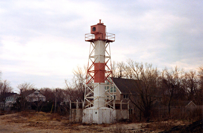 The tower was painted white with a red band around the center.  In 1856 Keeper Marsh L. Mount was appointed to the station and lit up the Conover Beacon.